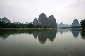foto of early 20s  - the famous 20 yuan banknote scenery taken early in the morning when the li river is calm - JPG