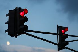 picture of traffic signal  - Traffic light with red light against the evening sky - JPG