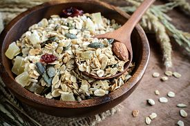 image of whole-grain  - Oat and whole wheat grains flake in wooden bowl on wooden table - JPG