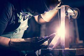 stock photo of tig  - Worker welding aluminum using tig welder in factory - JPG
