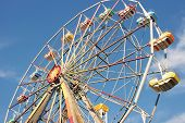 stock photo of ferris-wheel  - ferris wheel with blue sky background - JPG