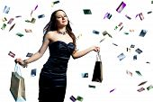 A Beautiful Portrait Of A Happy Attractive Woman With Credit Cards Raining Over Her