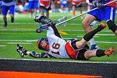 Lacrosse player falling down