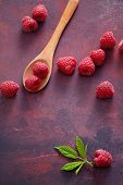 Raspberries with spoon. A fresh raspberry on a wooden spoon. Ripe fresh raspberries with leaves on r poster
