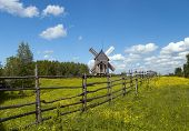 Rustic Landscape With Wind Mill