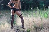 Young Woman In Stockings Standing In The Park, Free Space. Slender Legs In Stockings. poster