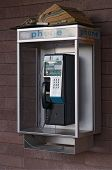 Closeup of public coin-operated telephone