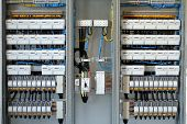 stock photo of busbar  - New control panel with static energy meters and circuit - JPG