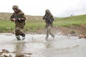 Soldiers Running Across The Water