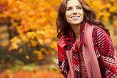 Fashion woman walking in autumn park poster