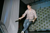 SAN DIEGO, CA - JULY 23: Actor Zachary Levi hands out special edition TV Guides after the TV Guide p
