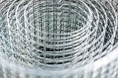 A Roll Of Hardware  Metal Mesh Cloth. Abstract Blurred Vision poster