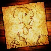 old treasure map, on wooden grunge background