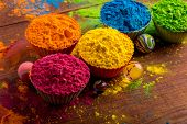 Holi color powder. Organic Gulal colours in bowl for Holi festival, Hindu tradition festive poster