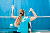 Women playing Badminton and doing sport in gym