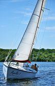 A Yacht Forwarding In A Turn