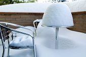 Table And Chairs Covered In Snow