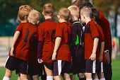 Youth Soccer Coach Coaching Boys Team. Soccer Team With Coach In Red Jersey Shirts poster
