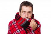 pic of shivering  - man wrapped in a warm blanket and scarf shivering from the cold on white background - JPG