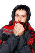 foto of shivering  - man in winter clothes shivering from the cold on white - JPG