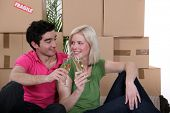 Couple having a celebratory drink on moving day