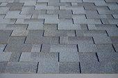Close Up View On Asphalt Roofing Shingles Background. Roof Shingles - Roofing. Bitumen Tile Roof. poster