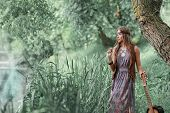 Beautiful Hippie Girl With A Guitar Standing Near A Forest Pond poster