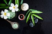 Thai Spa.  Top View Of White Plumeria Flower Setting For Massage Treatment And Relax On Black Blackb poster