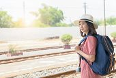 Hipster Young Traveler With Vintage Backpack At Railway Station, Travel Concept And Vintage Tone poster