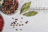 Assorted Pepper Spices. Pepper Mix. Black, Red And White Peppercorns And Dried Bay Laurel Leaves On  poster