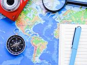 Top View Of A Map And Items. Planning A Trip Or Adventure. Travel Planning Dreams. Map Of The World. poster
