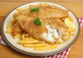 Fish and chips. Battered and deep fried cod fillet with fries.