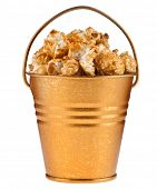 caramel popcorn in a bucket box isolated on white