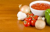 image of crimini mushroom  - A bowl of crushed tomatoes surrounded by onion - JPG
