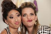 stock photo of bff  - Asian and European pair of women making faces - JPG