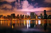 stock photo of new york night  - A shot of the New York City skyline at night - JPG