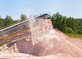foto of crusher  - stone crusher at quarry red marble summer - JPG