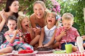 stock photo of jello  - Children And Mothers Eating Jelly And Cake At Outdoor Tea Party - JPG
