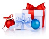 Two White Boxs Tied With A Satin Ribbon Bow, Red And Blue Christmas Balls Isolated On White Backgrou
