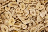 stock photo of fibrin  - Banana chips made from dehydrated slices of fresh ripe bananas