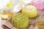 Traditional Chinese mid autumn festival food. Snowy skin mooncakes.  The Chinese words on the mooncakes is green tea with red bean paste, noble delight and lotus paste, not a logo or trademark.