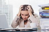 image of pulling hair  - Nervous businesswoman pulling her hair out in her bright office - JPG
