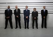 image of police lineup  - Businessmen standing in police lineup - JPG