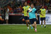 KUALA LUMPUR - AUGUST 9: FC Barcelona 's Lionel Messi (blue bib) practices during training at the Bukit Jalil Stadium on August 09, 2013 in Malaysia. FC Barcelona is on an Asia Tour to Malaysia.