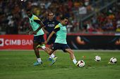 KUALA LUMPUR - AUGUST 9: FC Barcelona's Xavi Hernandez kicks the ball during training at the Bukit Jalil Stadium on August 09, 2013 in Malaysia. FC Barcelona is on an Asia Tour to Malaysia.