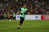KUALA LUMPUR - AUGUST 9: FC Barcelona goal keeper Jose Manuel Pinto jogs at training at the Bukit Jalil National Stadium on August 09, 2013 in Malaysia. FC Barcelona is on an Asia Tour to Malaysia.