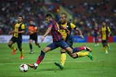 KUALA LUMPUR - AUGUST 10: FC Barcelona 's Neymar Jr. kicks the ball in a friendly game against Malaysia at the Shah Alam Stadium on August 10, 2013 in Malaysia. FC Barcelona wins 3-1.