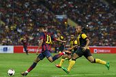 KUALA LUMPUR - AUGUST 10: FC Barcelona's Neymar (11) shoots at goal against the Malaysian team at the Shah Alam Stadium on August 10, 2013 in Malaysia. FC Barcelona wins 3-1.