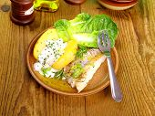 Fish, Potato With Quark, Salad And Fork