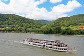 WACHAU, AUSTRIA - AUGUST, 2012 : Tourists cruises along the Danube river, Wachau, Austria on August